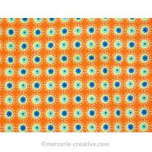 Coupon de tissu orange ronds verts et bleus