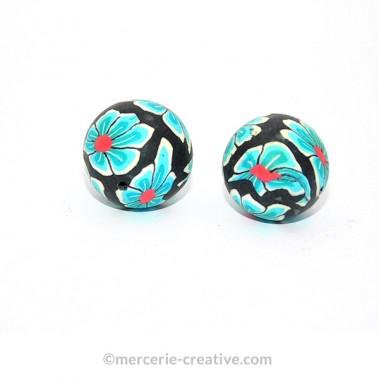 Perle fimo noire fleurs bleues X2