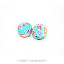Perle Fimo motif fleurs ton bleu-vert x2